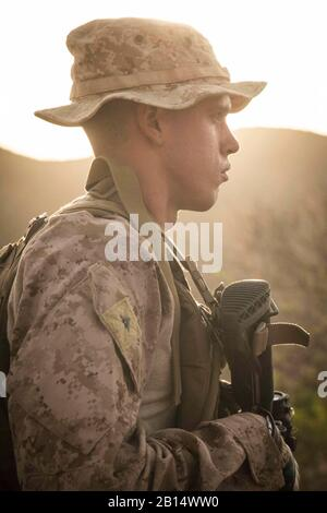 U.S. Marine Corps Lance Cpl. Riley Crider, a machine gunner assigned to Kilo Company, Battalion Landing Team 3/1, 13th Marine Expeditionary Unit, waits for orders during a fire team maneuver drill while participating in Theater Amphibious Combat Rehearsal (TACR) 18 in Djibouti Sept. 8, 2018. Led by Naval Amphibious Force, Task Force 51/5th Marine Expeditionary Brigade, TACR integrates U.S. Navy and Marine Corps assets to practice and rehearse a range of critical combat-related capabilities available to U.S. Central Command, both afloat and ashore, to promote stability and security in the regio