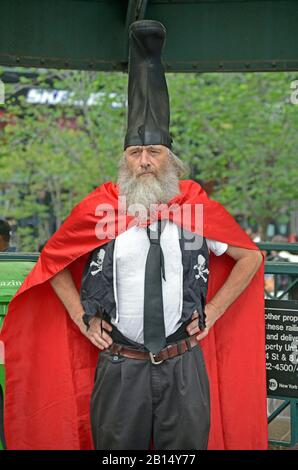 Portarit of VERMIN LOVE SUPREME, A performance artist, anarchist and occasional political candidate. In Union Square  Park in Manhattan. - Stock Photo