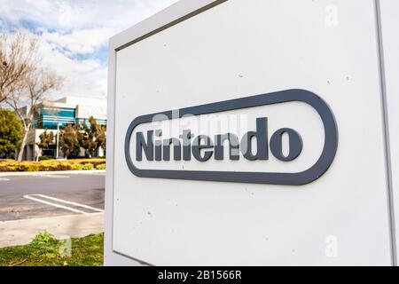 Feb 21, 2020 Redwood City / CA / USA - Nintendo sign at their headquarters in Silicon Valley; Nintendo Co., Ltd. is a Japanese multinational consumer - Stock Photo