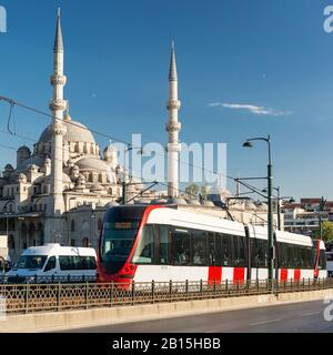 ISTANBUL - MAY 24, 2013: A modern tram rides over the Galata Bridge on may 24, 2013 in Istanbul, Turkey. Istanbul is a modern city with a developed in - Stock Photo