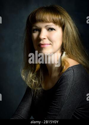 Portrait of a girl in the classic style of Rembrandt - Stock Photo