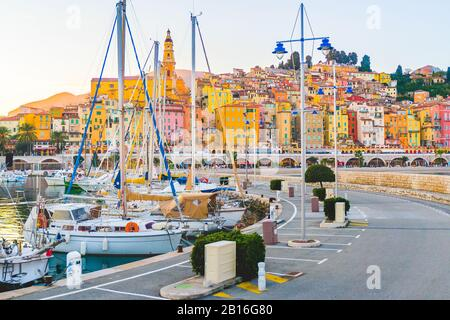 Panoramic view of colorful houses in old town in Provence village Menton, France, French Riviera. Provence Alpes Cote de Azur. Harbour with sailboats, - Stock Photo