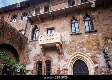 Patio and balcony of Romeo and Juliet house at golden sunset, Verona, Italy - Stock Photo