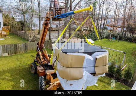 Construction details in progress boom truck forklift scale weight above blue sky with jacuzzi - Stock Photo