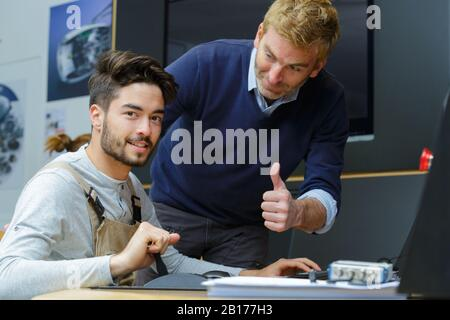 technicians stand in industry environment - Stock Photo