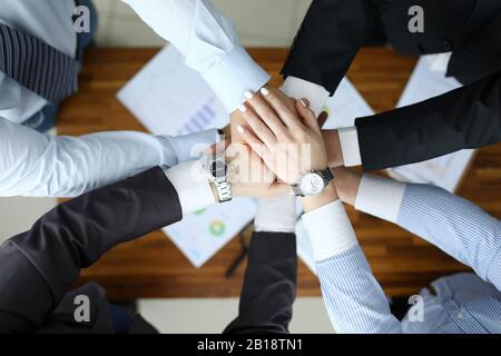 Business success concept. Group people hold together hand close up