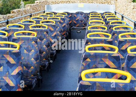 passenger seats on the top deck of a double decker nop-on hop-off bus - Stock Photo