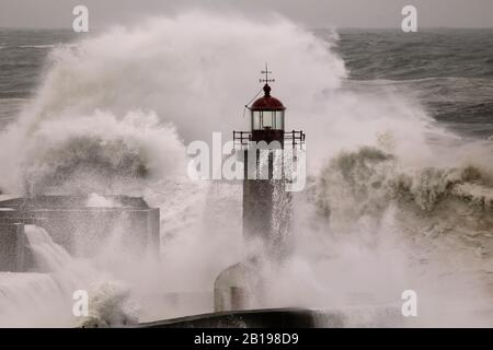 Storm at sea. Douro river old pier and lighthouse. - Stock Photo