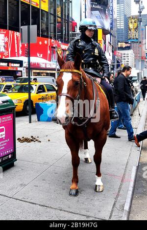 NYPD Officer on horseback in Times Square New York City, United Sates of America - Stock Photo