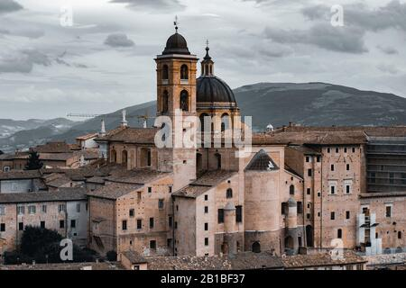 panoramic view of Urbino and ducal palace in Marche region, Italy - Stock Photo