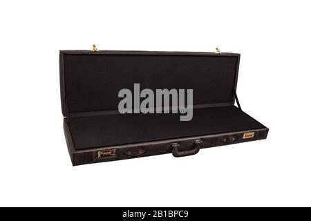 luxury brown leather case with gold-plated combination locks isolated on white background. Suitcase for weapons or musical instruments. - Stock Photo