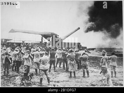 Discharge of a huge French cannon caught by the camera just as the projectile left for the German lines. by The U.S. - Stock Photo
