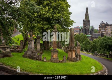 Glasgow, Scotland/UK - June 29, 2019: The Glasgow Necropolis, a Victorian cemetery, is located on a low, but very prominent hill to the east of Glasgo - Stock Photo