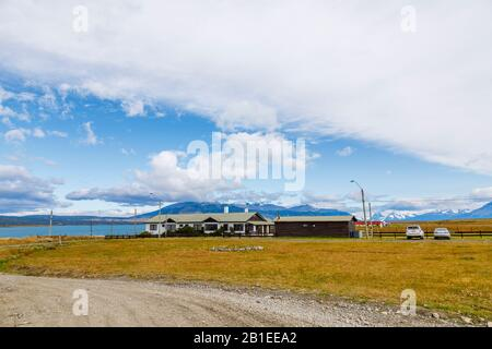 Low rise hotel on Senoret Channel, Puerto Bories, a small village in Patagonia near Puerto Natales, Ultima Esperanza Province, south Chile - Stock Photo