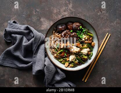 asian vegan soba noodle  with tofu cheese,shiitake mushroms, top view, copy space - Stock Photo