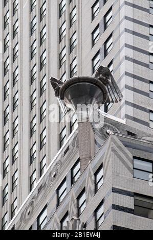 Detail of the Art Deco crown and spire of Chrysler Building in Midtown Manhattan at sunset. New York City USA