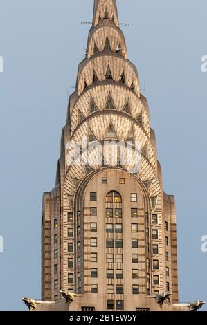 Detail of the Art Deco crown and spire of Chrysler Building in Midtown Manhattan at sunset. Aerial view. New York City USA