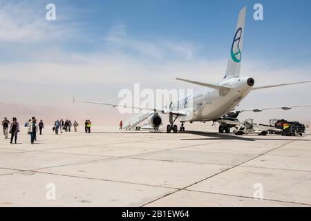 Aqaba, Jordan, April 27, 2009: A Slovenian Adria Airways airplane sits on the tarmac of the King Hussein International Airport in Aqaba, Jordan. - Stock Photo