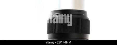Modern prime lens dusty focus rubber grip ring with bright white background - Stock Photo