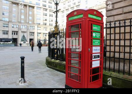 classic red phone booth box used as defibrillator storage in liverpool england UK - Stock Photo