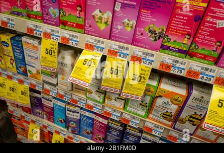 Children's cough and cold remedies on drug store shelves in New York on Thursday, February 13, 2020  (© Richard B. Levine) - Stock Photo