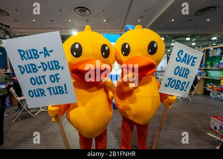 """""""Out of work"""" rubber duckies protest at the """"Blockaroos"""" booth at the 117th North American International Toy Fair in the Jacob Javits Convention center in New York on Sunday, February 23, 2020. The ducks were protesting their replacement in baths by the Blockaroo toys..  The toy industry generates over $26 billion in the U.S. alone and Toy Fair is the largest toy trade show in the Western Hemisphere. (© Richard B. Levine) - Stock Photo"""