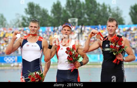 Shunyi, CHINA. right, Bronze medalist NZL 1X, Mahe DRYSDALE, Gold Medalist NOR M1X Olaf TUFTE and Sliver medalist, CZE M1X, Ondrej SYNEK, men's single, at the 2008 Olympic Regatta, Shunyi Rowing Course.  Sat,.16.08.2008.  [Mandatory Credit: Peter SPURRIER, Intersport Images - Stock Photo