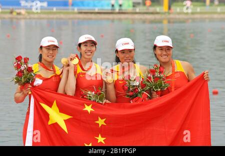 Shunyi, CHINA. Medal Presentation Gold  Medalist.  CHN W4X.  winning and celebrating the Gold medal at the 2008 Olympic Regatta, Shunyi Rowing Course.  Sun 17.08.2008.  [Mandatory Credit: Peter SPURRIER, Intersport Images.  Gold medalist CHN W4X left to right  Bin Tang, Jin Ziwei, Aihua Xi, Yangyang Zhang)  Bronze medalist GER W4X left to right Britta Oppelt, Manuela Lutze, Kathrin Boron, Stephanie Schiller) - Stock Photo