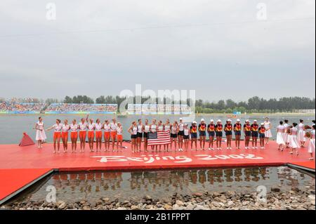 Shunyi, CHINA. Medal Presentation.  Women's Eights. left to right, NED W8+ silver medalist, Centre USA W8+ Gold Medalist and Bronze medalist ROM W8+2008 Olympic Regatta, Shunyi Rowing Course.  Sun 17.08.2008.  [Mandatory Credit: Peter SPURRIER, Intersport Images.  centre; Gold medalist CHN W4X left to right  Bin Tang, Jin Ziwei, Aihua Xi, Yangyang Zhang)  Left; Silver medalist GBR W4X Annie VERNON, Debbie FLOOD, Frances HOUGHTON and Katerine GRAINGER  right;  Bronze  medalist  GER W4X left to right Britta Oppelt, Manuela Lutze, Kathrin Boron, Stephanie Schiller) - Stock Photo