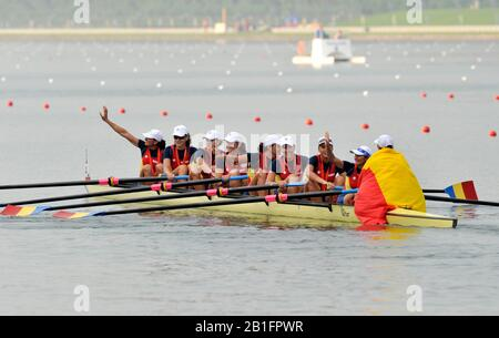 Shunyi, CHINA. Medal Presentation.  Women's Eights. Bronze medalist ROM W8+2008 Olympic Regatta, Shunyi Rowing Course.  Sun 17.08.2008.  [Mandatory Credit: Peter SPURRIER, Intersport Images.  centre; Gold medalist CHN W4X left to right  Bin Tang, Jin Ziwei, Aihua Xi, Yangyang Zhang)  Left; Silver medalist GBR W4X Annie VERNON, Debbie FLOOD, Frances HOUGHTON and Katerine GRAINGER  right;  Bronze  medalist  GER W4X left to right Britta Oppelt, Manuela Lutze, Kathrin Boron, Stephanie Schiller) - Stock Photo