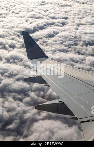 Oaxaca, Mexico - The view from the wing of an American Airlines jet flying over clouds. - Stock Photo
