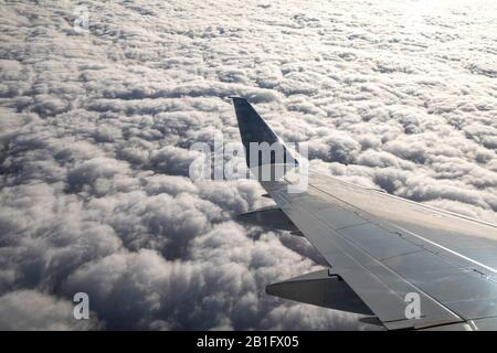 Oaxaca, Mexico - The view from the wing of an American Airlines jet flying over clouds.
