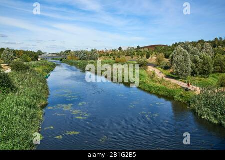 The Northern Parklands in Stratford Olympic Park, East London UK, in summer, with the River Lea - Stock Photo