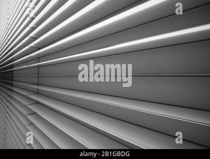 Perspective view of the fins of the building at the base of the Allianz Tower in Citylife, Milan, Italy - Stock Photo