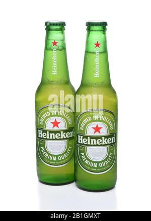 IRVINE, CA - MAY 29, 2017: Heineken Beer bottles on white. Since 1975, most Heineken beer has been brewed at the brewery in Zoeterwoude, Netherlands. - Stock Photo