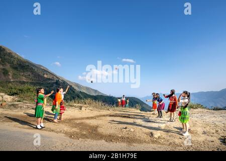 Ta Xua, Son La province, Vietnam - January 21, 2020: H'mong children play handball in Son La, Vietnam. At the time of the Lunar New Year at the end of - Stock Photo