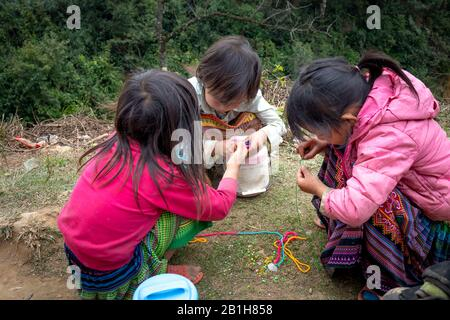 Ta Xua, Son La Province, Vietnam - February 3, 2020: H'mong children play with beads in Son La, Vietnam. - Stock Photo