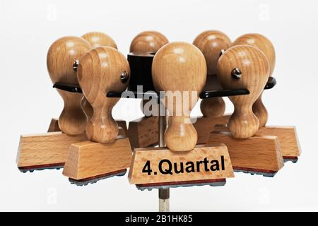 a stamp with the inscription 4. Quartal (4th quarter) hangs in a stamp rack - Stock Photo