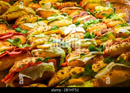 Lots of sandwiches in a display window of a diner cooking for sale. - Stock Photo