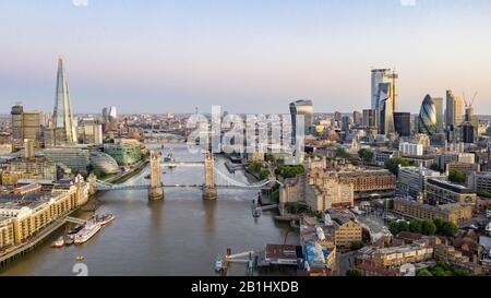 Aerial view of Tower Bridge, Shard and London, drone over the River Thames - Stock Photo