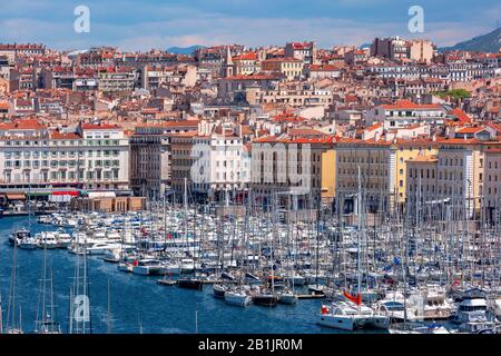 Aerial view of Old Vieux Port on sunny day in the historical city center of Marseilles, France