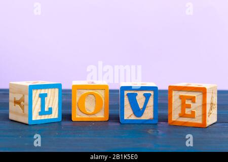 cube wooden block with alphabet building the word love - Stock Photo