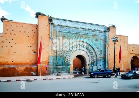 Marrakesh, Morocco - November 22nd 2014: Unidentified people and city wall with Bab Agnaou and stork nests - Stock Photo