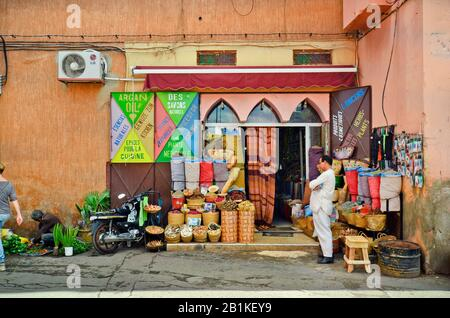 Marrakesh, Morocco - November 22nd 2014: unidentified people and grocery with different goods - Stock Photo