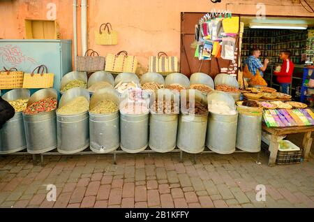 Marrakesh, Morocco - November 22nd 2014: Unidentified people and shop with different goods - Stock Photo
