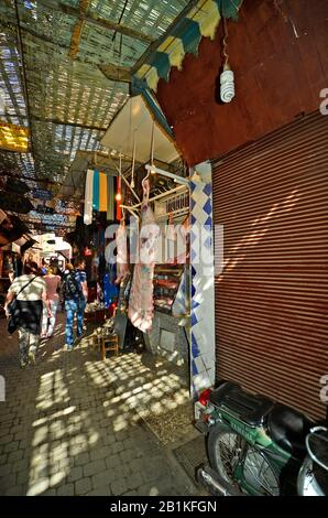 Marrakesh, Morocco - November 22nd 2014: Unidentified people in the souk of the old part named Medina - Stock Photo