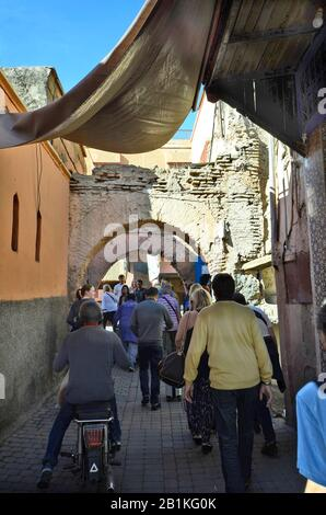 Marrakesh, Morocco - November 22nd 2014: Crowd of unidentified people in narrow street of the souk - Stock Photo