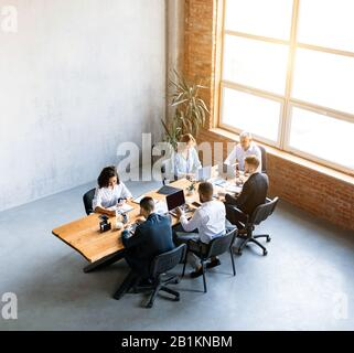 Business People Working Sitting At Desk In Modern Office, High-Angle