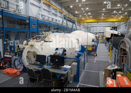 Mockups of various spacecraft including the Soviet portion of the International Space Station (ISS) used for astronaut training at a cavernous NASA Johnson Space Center facility in Houston. - Stock Photo