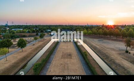 Oberhausen, North Rhine-Westfalia, Germany - August 06, 2018: Sunset over the Ruhr Area, seen from the lookout tower at the Olga-Park - Stock Photo